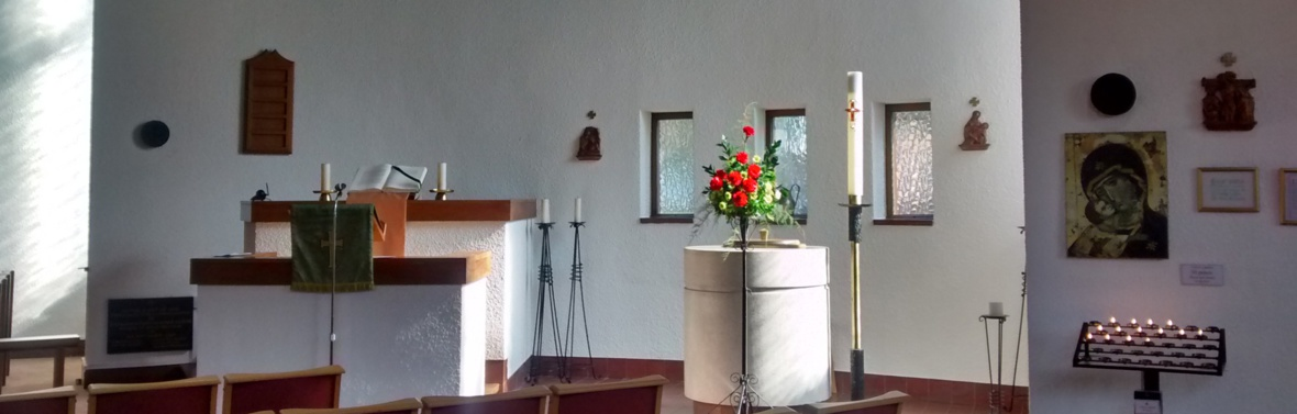 Wide view of pulpit, font and our Lady